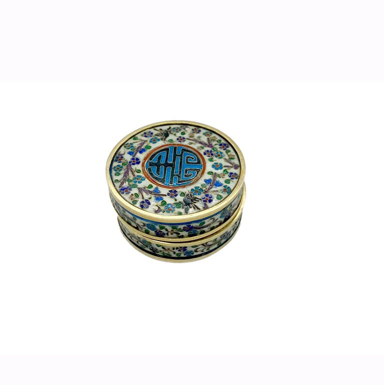 A beautiful Art Nouveau pill box decorated with enameled East Asian motifs. Early twentieth century.