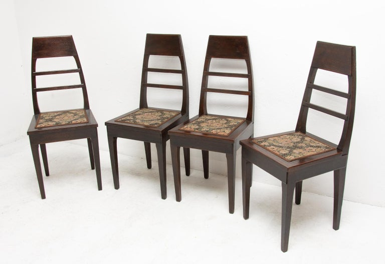 These secession dining chairs were produced in Bohemia- Austria-Hungary, circa 1910. They are made of dark stained oakwood. They feature an original upholstery. The chairs are in very good condition, they have been renovated using shellac. Price is