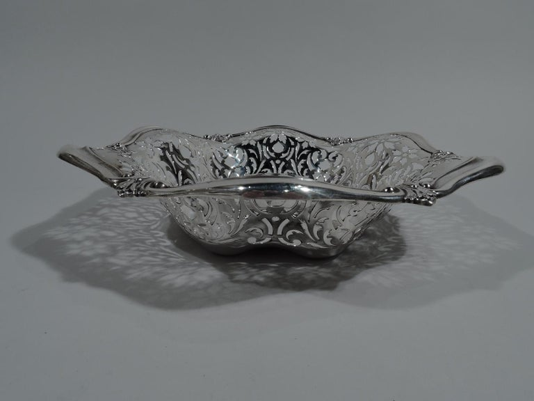 Pretty Art Nouveau sterling silver bowl. Made by Gorham in Providence in 1908. Solid and lobed well. Sides pierced with flowers and scrolls. Wavy and scrolled rim with applied leaves. Fully marked including date symbol and no. A7362. Weight: 8.5