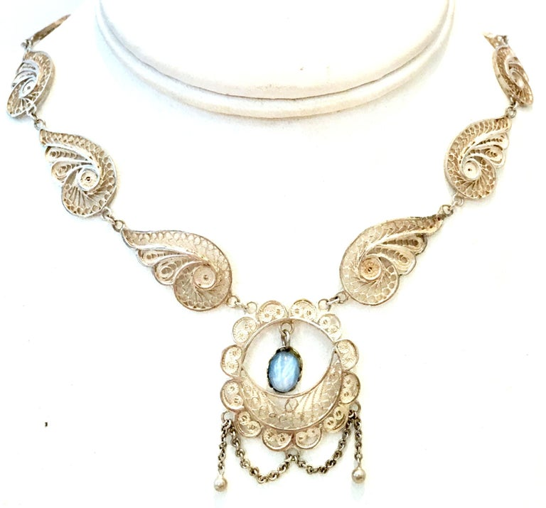 Antique Art Nouveau Sterling Silver Filigree & Moonstone Necklace. This one of a kind delicate and substantial artisan piece features a sterling silver necklace with intricate filigree feathered scroll detail and a single prong set moonstone
