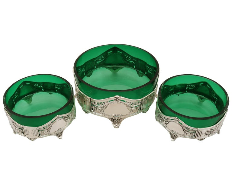 A fine and impressive suite of three antique German silver and green glass dishes in the Art Nouveau style; an addition to our silver mounted glass collection