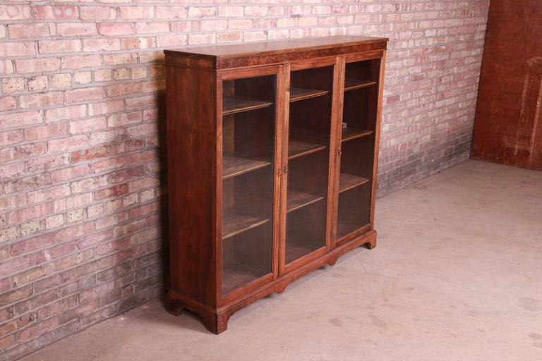 Antique Arts & Crafts Mahogany and Burled Walnut Glass Front Triple Bookcase In Good Condition For Sale In South Bend, IN