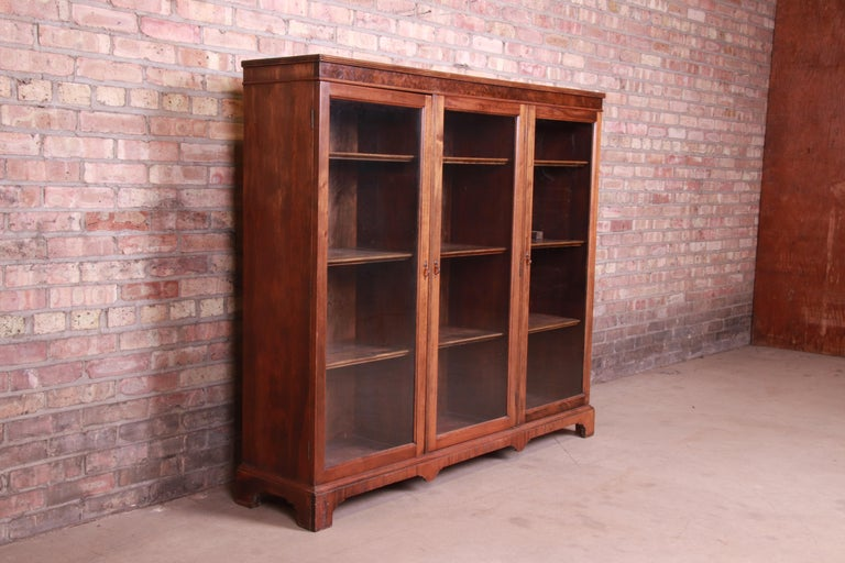 20th Century Antique Arts & Crafts Mahogany and Burled Walnut Glass Front Triple Bookcase For Sale