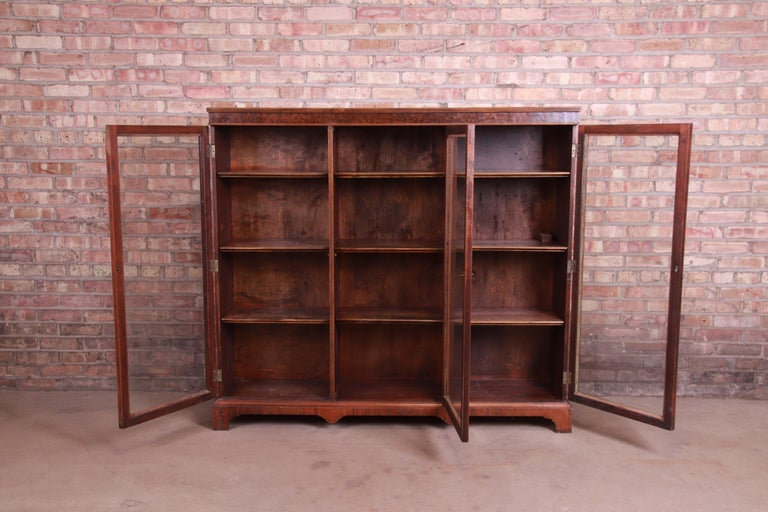 Brass Antique Arts & Crafts Mahogany and Burled Walnut Glass Front Triple Bookcase For Sale