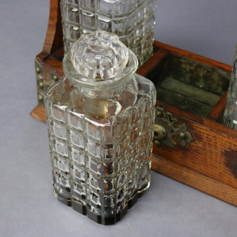 20th Century Antique Arts & Crafts Oak Tantalus Set with Three Decanters, circa 1900 For Sale