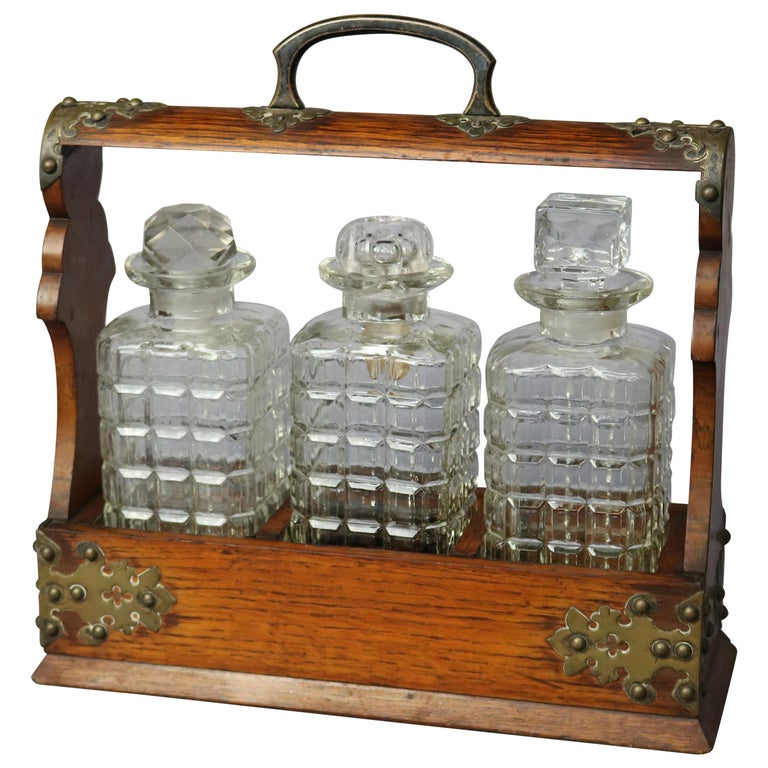 Antique Arts & Crafts Oak Tantalus Set with Three Decanters, circa 1900 For Sale
