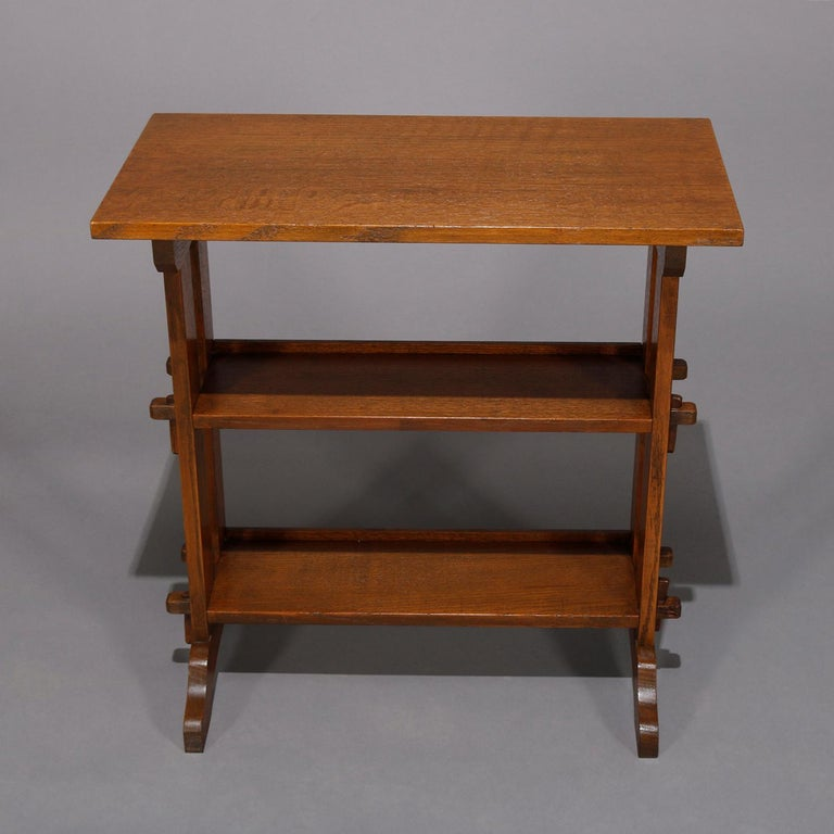 An antique Arts & Crafts mission oak little journey bookstand by Roycroft offers quarter sawn oak construction with upper counter over two mortise and tenon shelves, maker label as photographed, circa 1900.  ***DELIVERY NOTICE – Due to COVID-19 we