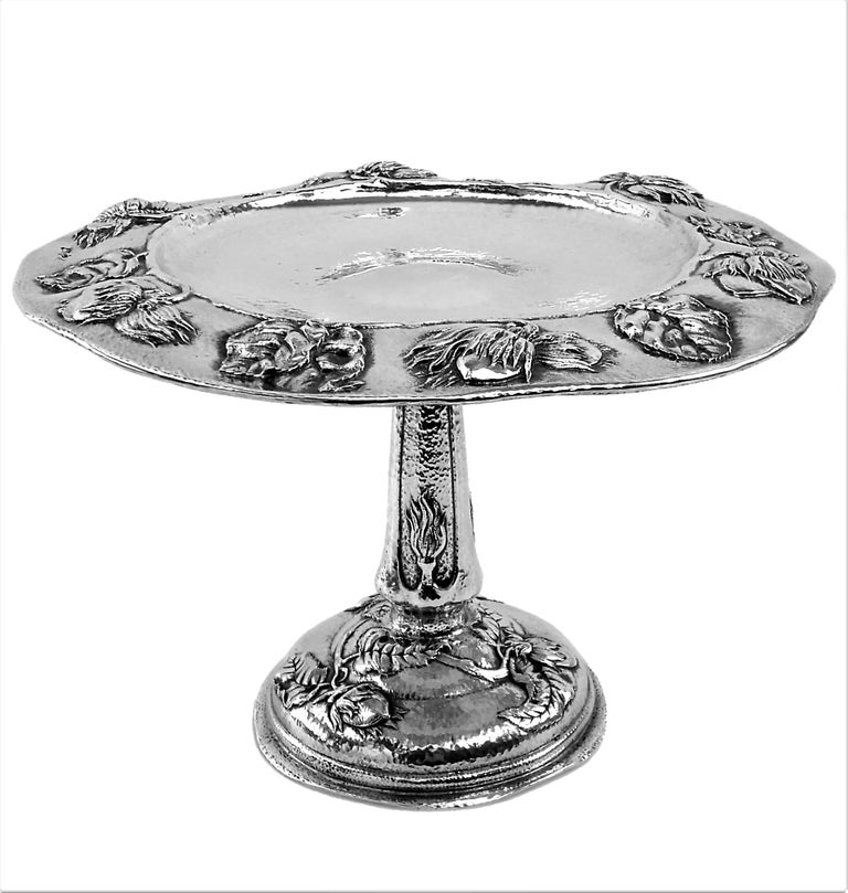 A gorgeous Antique Sterling Silver Arts & Crafts Dish / Tazza Comport with a wide shallow bowl on a tall column and a domed pedestal foot. The body of the Dish is covered in a hammered patterning while the Rim of the Bowl, The central column and the