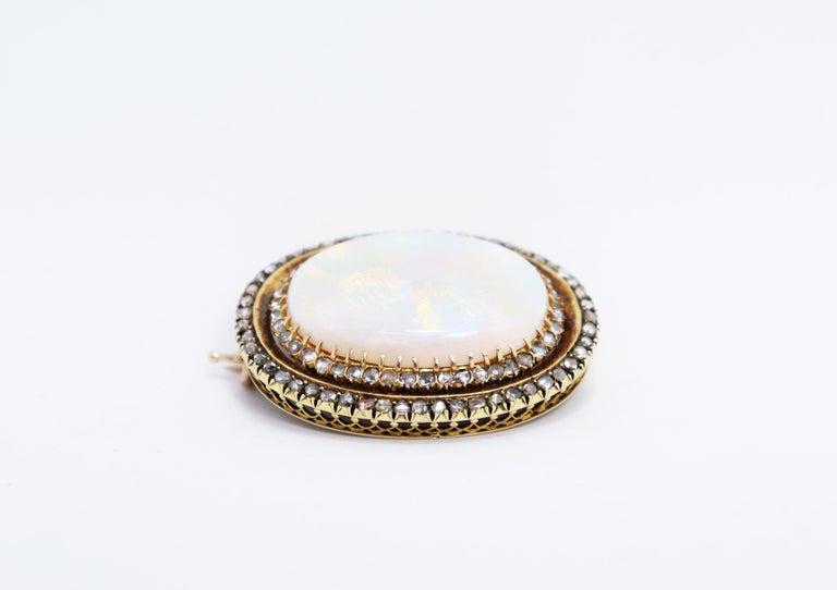 Oval Cut Antique Australian Opal and Diamond 18 Carat Gold Brooch, circa 1900s For Sale