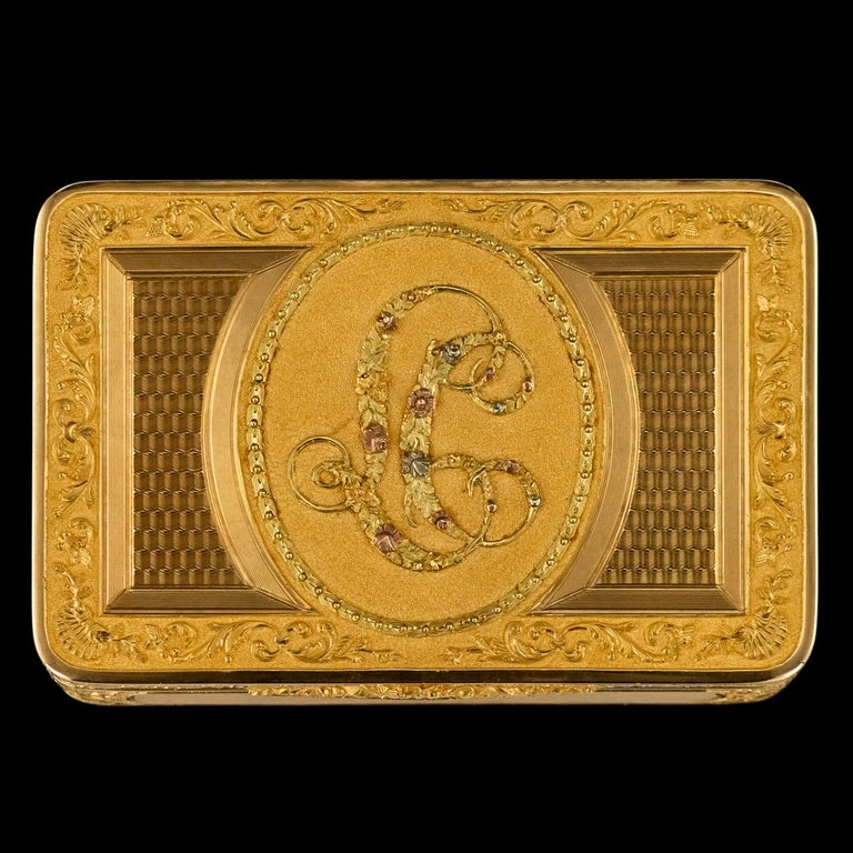 Antique early 19th century Austrian exceptional four-color 18 karat gold snuff box, of rectangular form with rounded corners, the hinged covers beautifully engraved with shell and scroll decoration, engine turning in reserves and applied with an