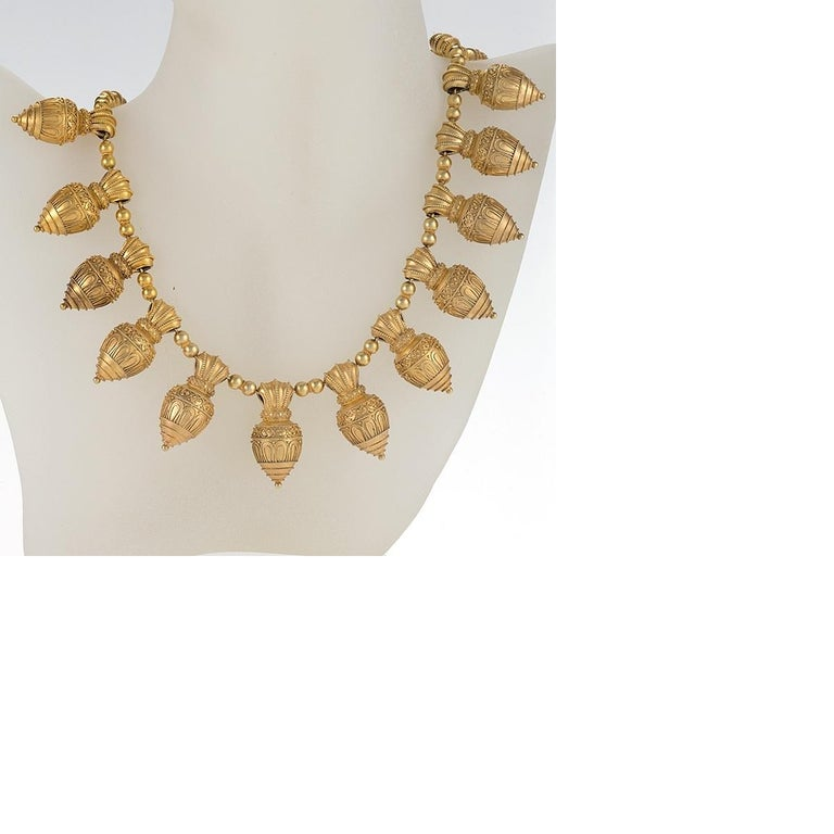 An Austro-Hungarian Etruscan Revival 18 karat gold necklace. The necklace is composed of 20 wire and bead-work embellished cones. Circa 1880's.   In Italy, goldsmiths had been reviving the Etruscan Archeological-style jewelry unearthed at Pompeii