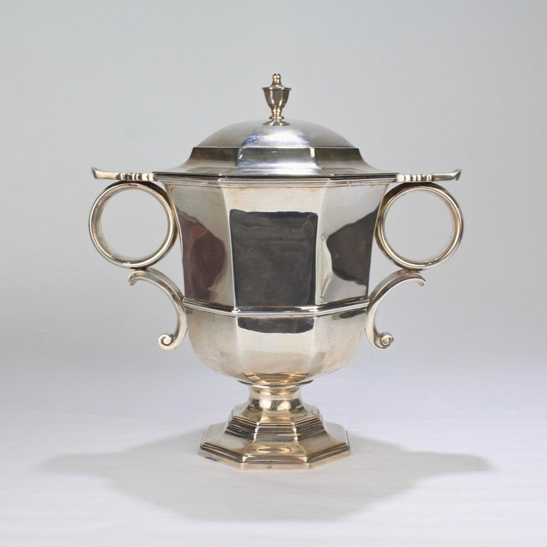 A wonderful sterling silver loving cup and cover by the celebrated Philadelphia jewelers and silversmiths - Bailey, Banks, and Biddle.  A faithful copy of a George II Loving Cup with a urn form body, loop handles, and a conforming cover, it is one