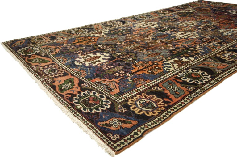 75325, antique Bakhtiari area rug with Four Seasons Garden design. Rich and vibrant colors integrated with a softened patina, this antique Persian Bakhtiari rug features a traditional modern style. Classically composed and boasting a truly