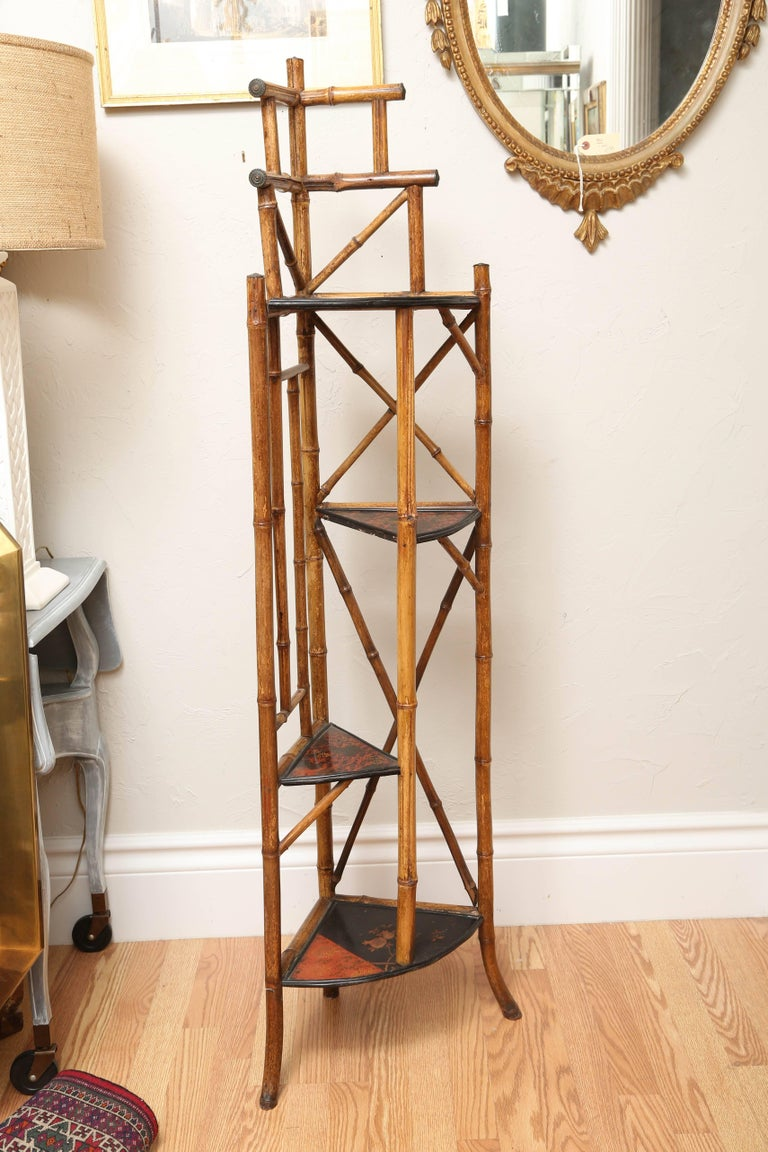 English antique bamboo corner whatnot with multiple shelves.