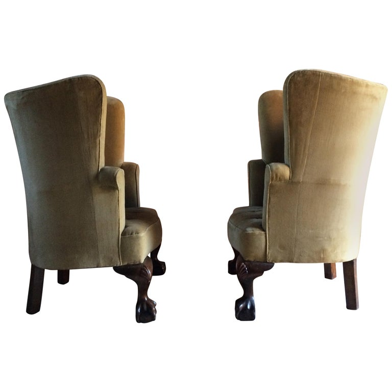 A stunning pair of 19th century George II style mahogany barrel back porters armchairs dating to circa 1860, the chairs upholstered in gold velvet, standing on oversized carved ball and claw cabriole legs, these chairs are breathtakingly beautiful