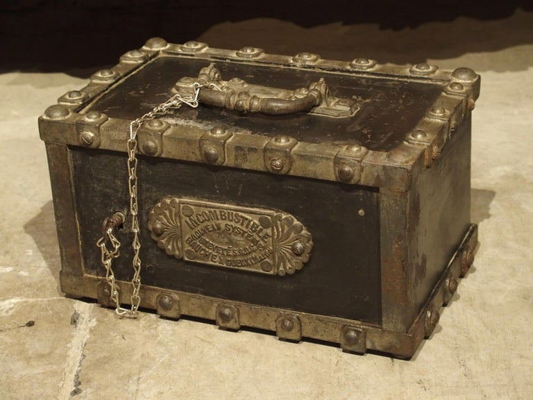 This antique incombustible cast iron safe is from Northeastern France (Gueux, Marne). Inside, it still has its original felt with the maker's name on a front mounted plaque. This antique French safe will be wonderful for valuables or as a decorative