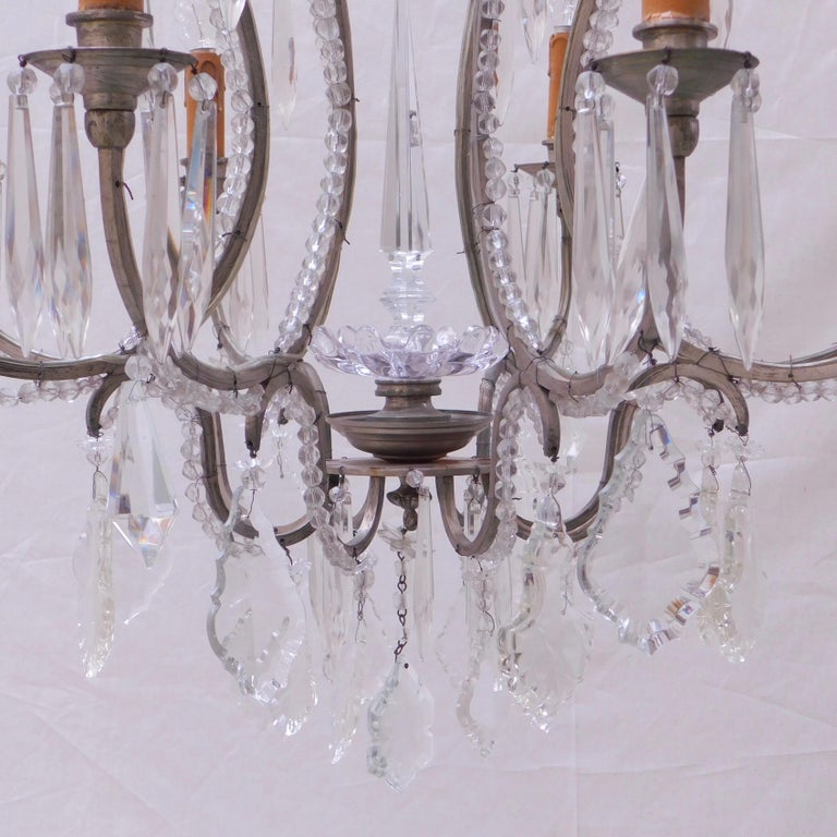A most elegant Belgian chandelier with a silver plated metal frame beaded with prism cut glass beads and hanging crystal prisms. Wired and ready to hang. The height listed is to the top of the ceiling cap canopy.