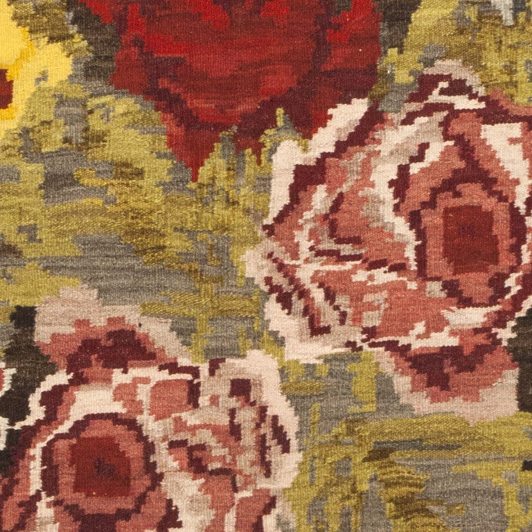 Antique Bessarabian Kilim, Origin: Romania, circa early 20th century – Size: 7 ft 6 in x 11 ft 4 in (2.29 m x 3.45 m)  This dramatic antique Bessarabian kilim rug depicts a lavish millefleur bouquet with beautifully shaded blossoms and subtly