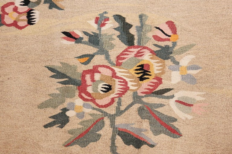 Antique Besserabian Kilim, Country of Origin: Romania, circa 1920. Size: 7 ft 7 in x 10 ft 8 in (2.31 m x 3.25 m)   This large antique rug from Romania is a stunning example of the Besserabian flat weave. It features a calming color theme and a
