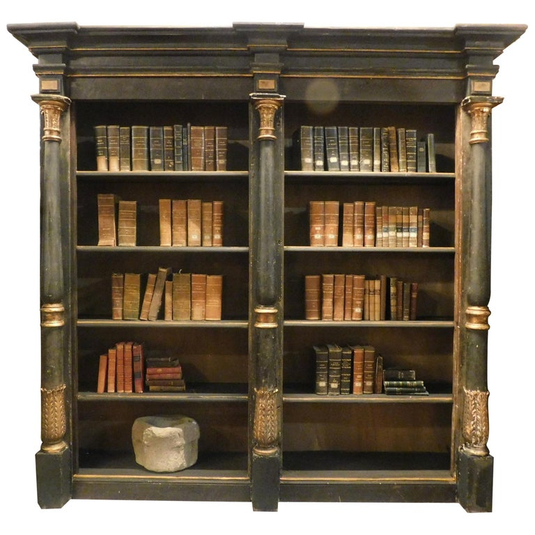 Black- and gold-lacquered wood bookcase, 1810, offered by Simone Marro