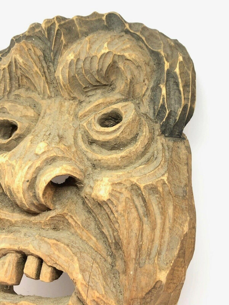 Beautiful black forest Folk Art wood carved mask. This is a wonderful example of black forest carving. This can be used as a Wall decoration or as a wearable mask. Found at an estate sale in Nuremberg, Germany.