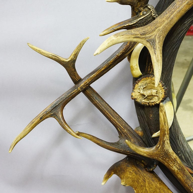 Carved Antique Black Forest Mirror with Rustic Antler Decorations, ca. 1900 For Sale