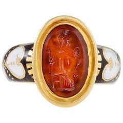 Antique Black, White Enamel and Gold Ring Featuring a Red Intaglio Carving