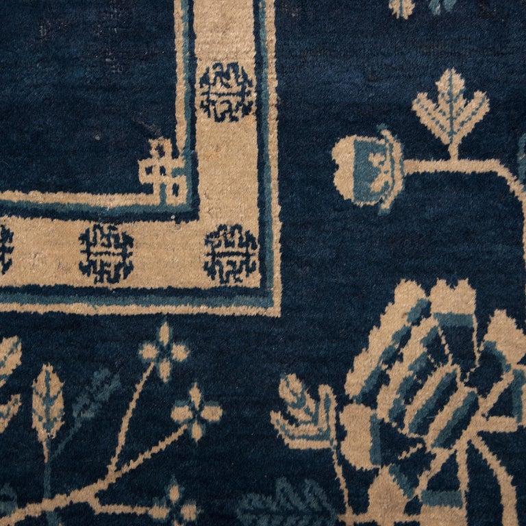 Wool Antique Blue and White Khotan Carpet, c. 1930 For Sale