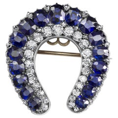 Antique Blue Sapphire and Diamond Horseshoe Brooch