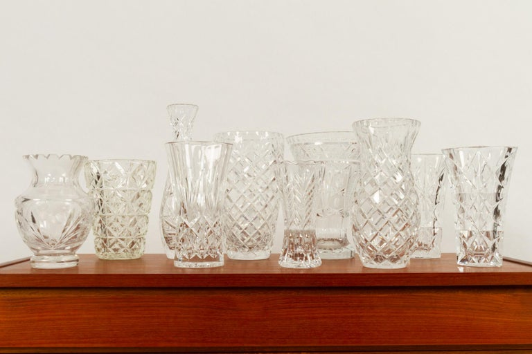 Antique Bohemian lead crystal vases set of 10. Set of ten different antique cut crystal vases, with different cut decorations, first half of the 20th century. Size: Height 15 - 26cm. With good weight, no damage, chips or cracks.