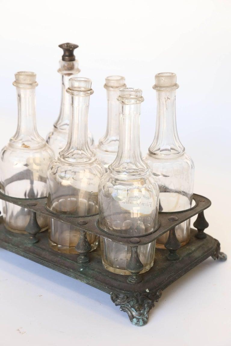Glass Antique Bottle Holder with Bottles For Sale