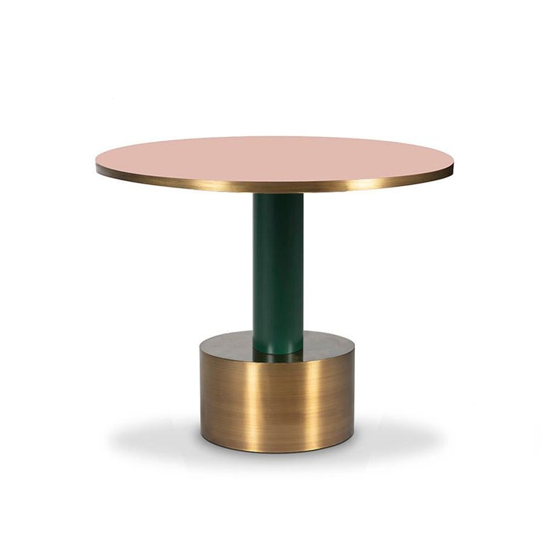 Crafted in antique brass with your choice of lacquered wood, Rio is tropical and sexy. This dining table seems to move with a casual samba swing. Get yours and live the endless carnival.  Made of antique brass and lacquered wood.