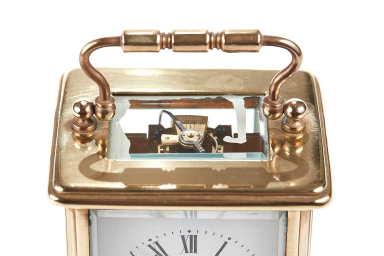 Antique brass Carriage clock, the dial signed Reid & Sons, Newcastle on Tyne. 8 day movement. Perfect working order, lovely condition and original key.