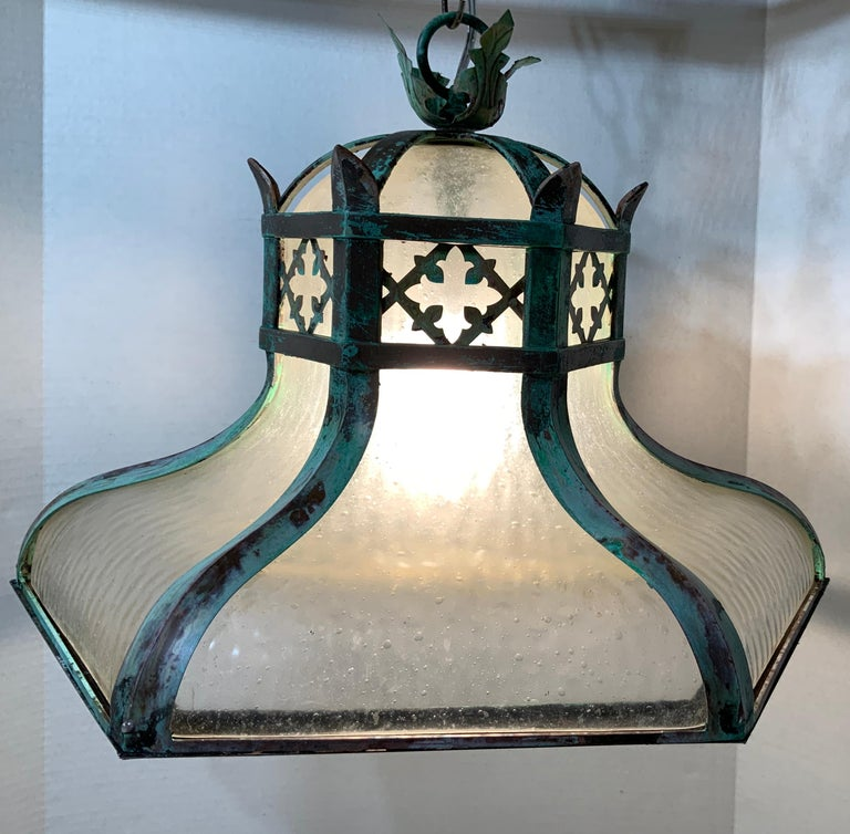 Elegant antique chandelier made of solid brass with blown glass inner. Exceptional style of crown look with beautiful oxidized greenish patina. Newly rewired with one-light, look at capacity of the light in the photos. Great decorative light.
