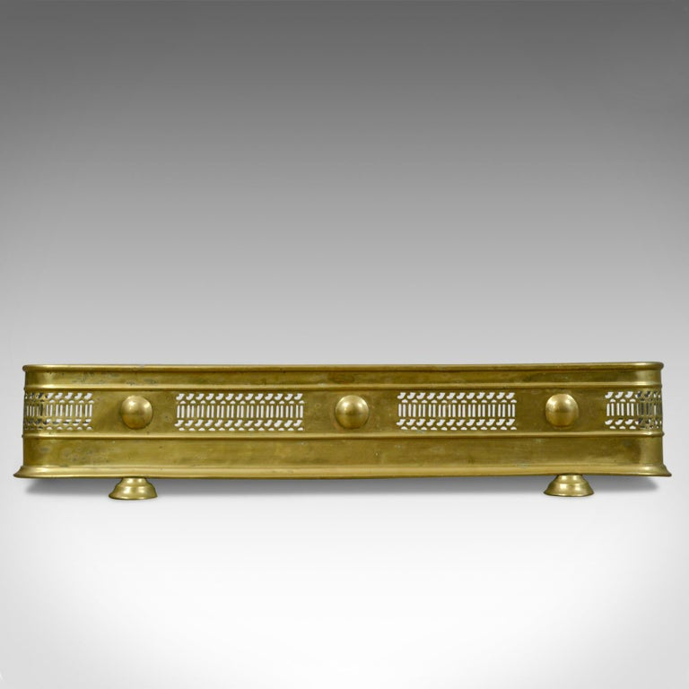 This is an antique brass fire kerb, Victorian fireside fender, English, circa 1890.