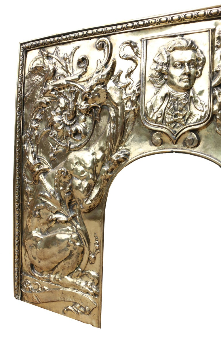 An unusual brass fireplace insert featuring dragons and and a gentleman in 19th century dress, possibly Bach. We believe the plaque could be removed if required and the brass underneath polished.  Condition report:  Good structural condition. No