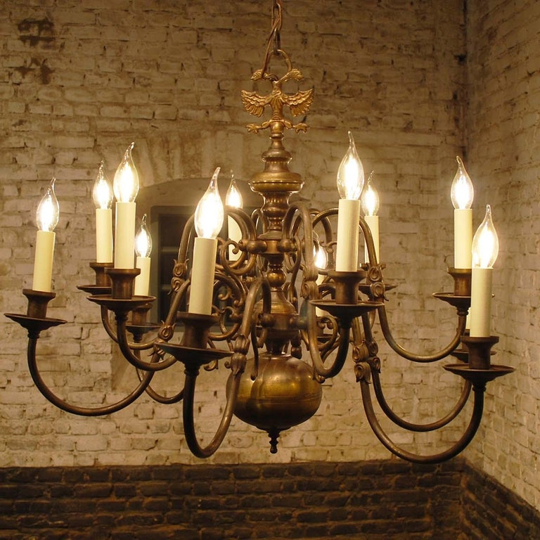 A twelve-light Baroque style patinated brass Dutch chandelier with ball-shaped elements. 