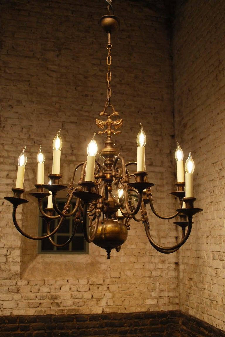 Baroque Antique Brass Two-Tier Twelve Light Bulbous and Scrolled Dutch Chandelier For Sale