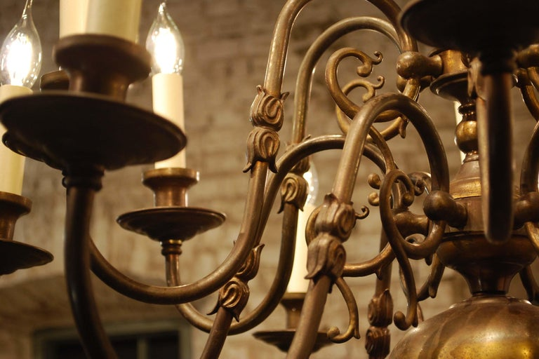 20th Century Antique Brass Two-Tier Twelve Light Bulbous and Scrolled Dutch Chandelier For Sale