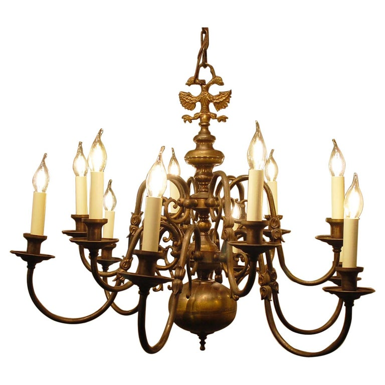 Antique Brass Two-Tier Twelve Light Bulbous and Scrolled Dutch Chandelier For Sale