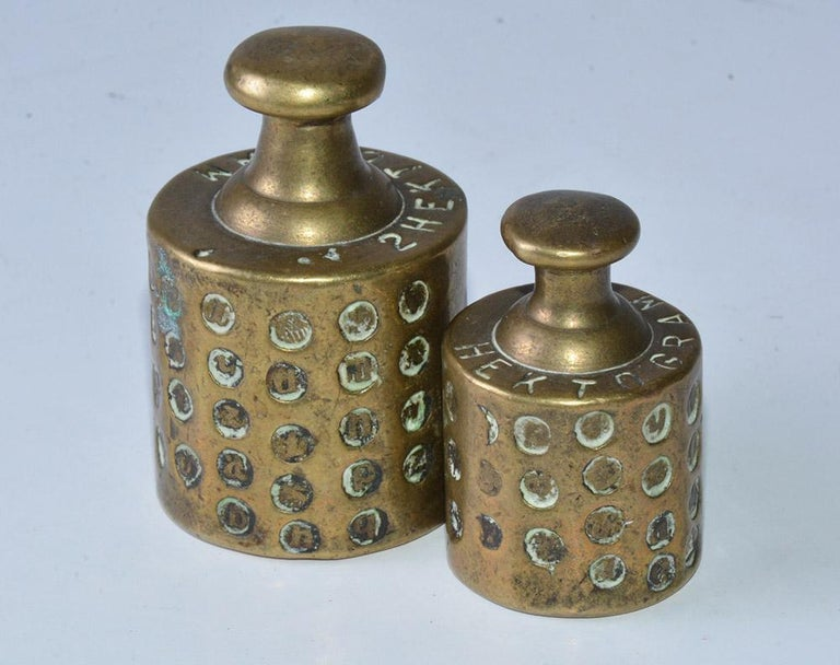 Antique brass scale weights very richly calibrated and marked. Stamps on the weights are an indication of regular inspections to verify the accuracy of the weights by an official inspector. Wonderful for any desk as paper weights or