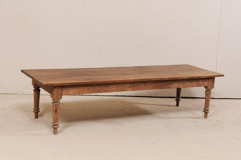 A Brazilian wooden bench (or table) from the early 20th century. This antique bench from Brazil, approximately 6.25 feet in length, has been constructed of a tropical hardwood and features a long, rectangular-shaped top, plain skirt, and supported