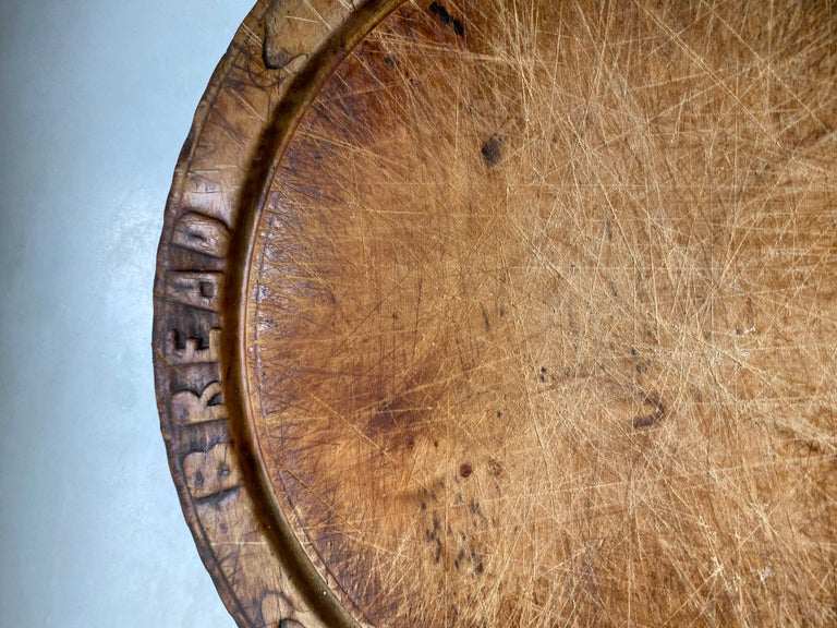 Once standard item found in an English country home, these antique Victorian hand carved breadboard have become a rarity. This particular one has a warm timeless rich aged patina. The bread board is hand carved with