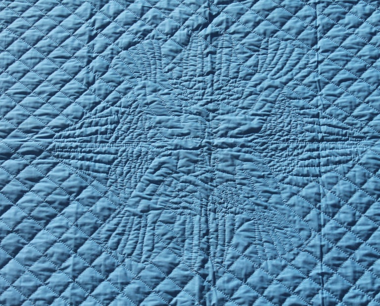 This finely quilted bridal quilt is reversible and was made in Lancaster County Pennsylvania. It is blue on one side and white on the other side. Heavy beautiful feather quilting. Would make a Fantastic wedding gift Take notice of the four doves in