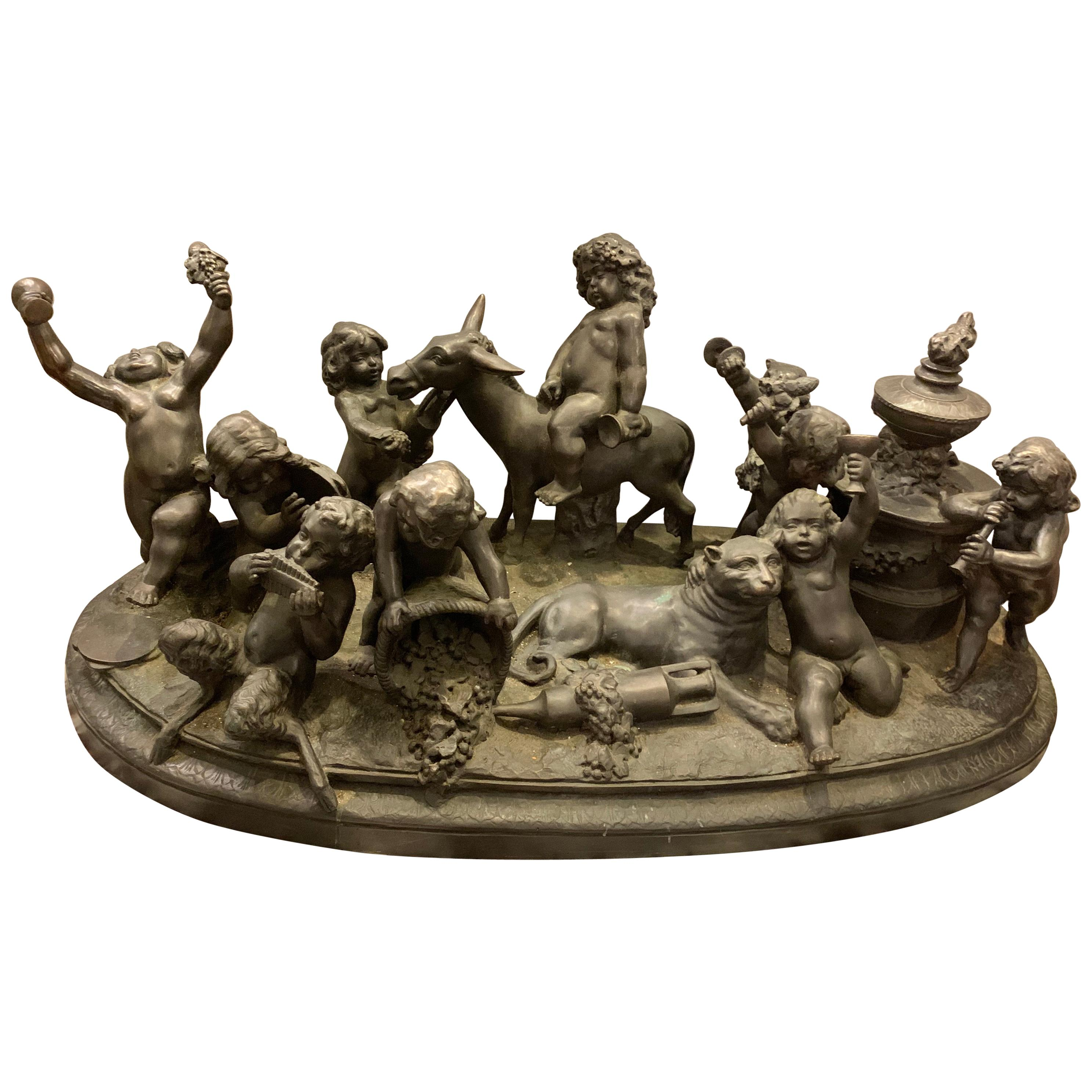 Antique Bronze Cherub Group Sculpture or Centerpiece of Drunken Playing Cherubs