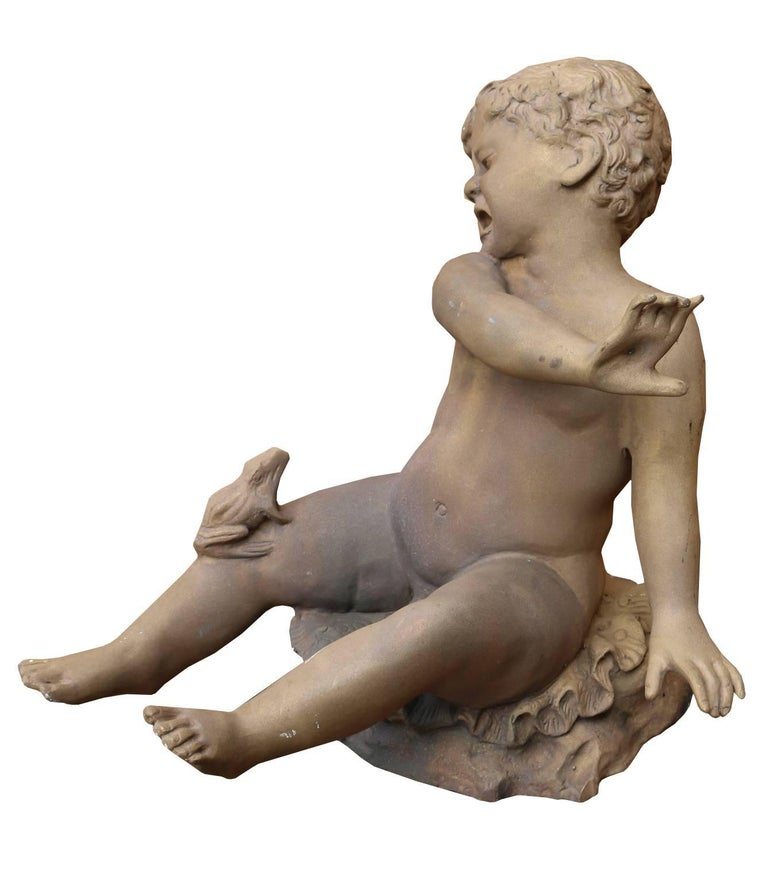 A good quality bronze fountain depicting a young boy being sprayed with water by a frog. There is a copper pipe fitted to the underside.