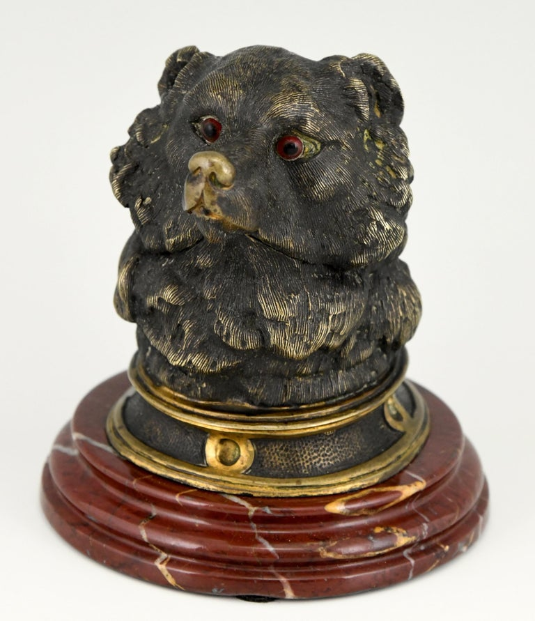 Antique bronze inkwell in the shape of a bear's head with glass eyes. The sculpture is mounted on a red marble base and has a glass container.  France, ca. 1880.