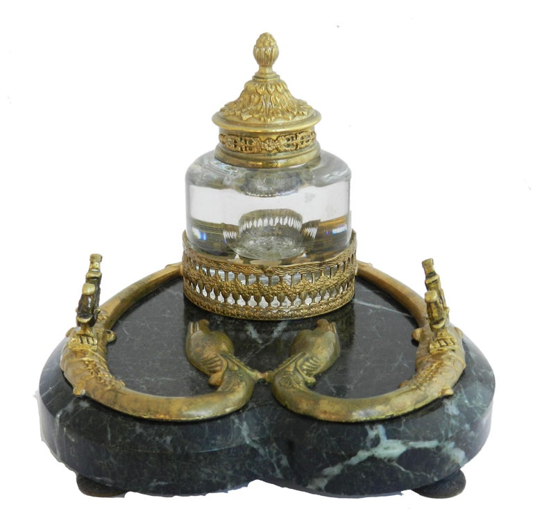 Antiquebronze marble inkwell desk crystal inkstand French c1880 Unusual serpent base Bronze on variegated marble base Holds pen across the top  With crystal inkwell Good condition with only minor signs of wear for its age.