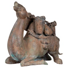 Antique Bronze Sculpture of a Camel Carrying Baskets with Verdigris Patina
