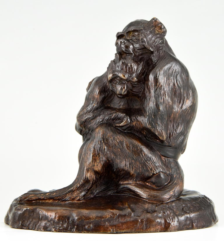 """Antique bronze sculpture of two monkeys, mother and child by the French artist Thomas Cartier, 1879-1943, with a beautiful dark brown patina. Literature: """"Bronzes, sculptors and founders"""" by H. Berman, Abage. ?""""Les bronzes de XIXe siècle"""" by"""